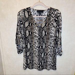 Isabella Rodriguez snake skin print shirt. size L.